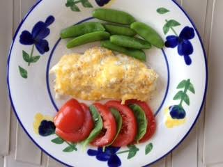 Baked fish w: cheese; snap peas, toms:basil